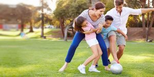 Healthy family playing in the park